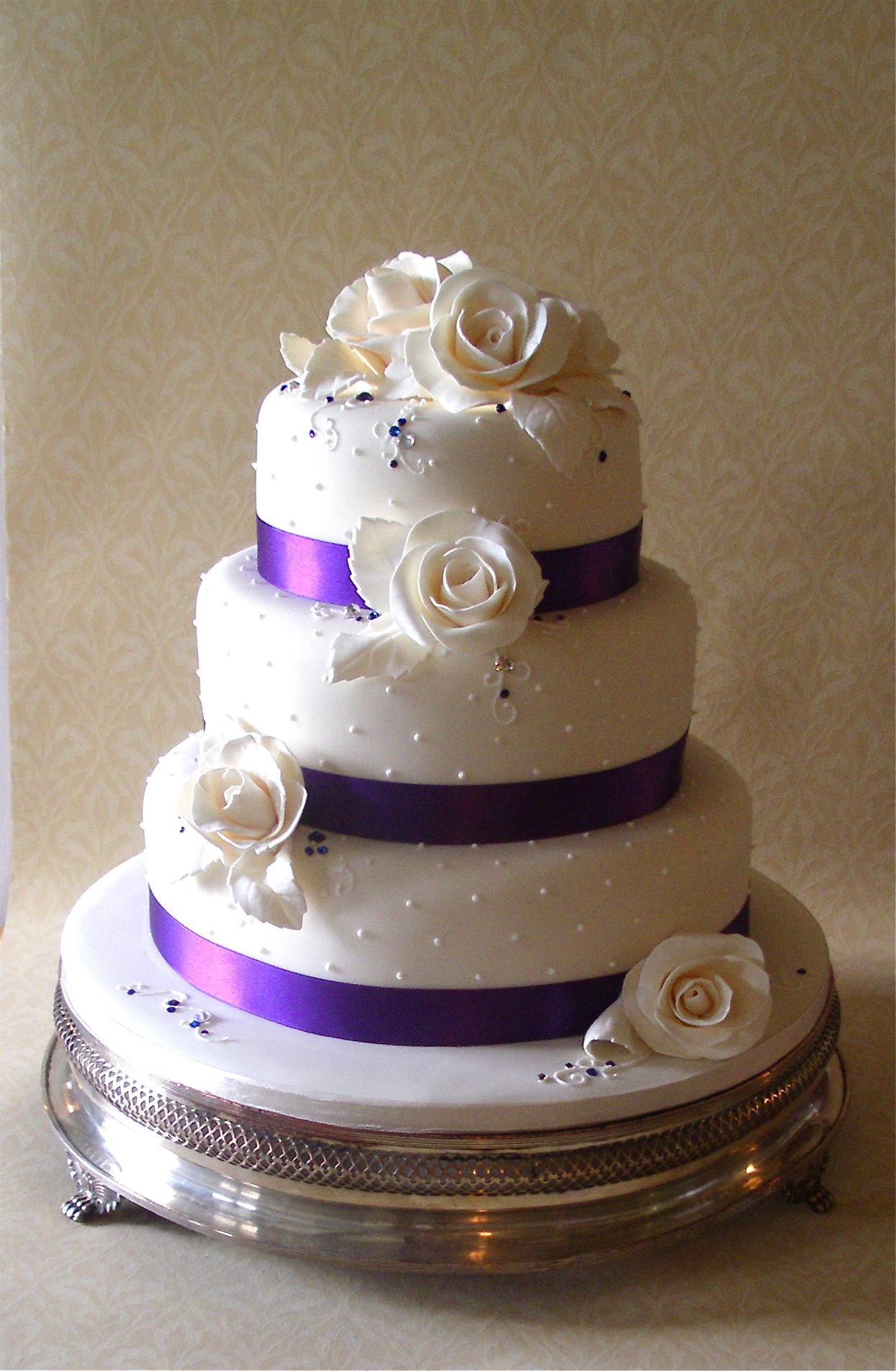 ivory wedding cake with purple roses ivory amp purple wedding cake flickr photo 16552