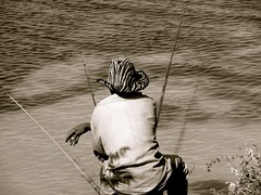 person fishing with a fishing pole