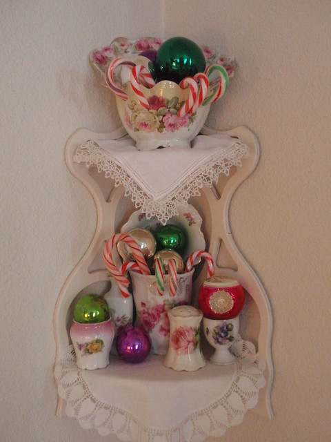 Corner shelf with ornaments & candy canes