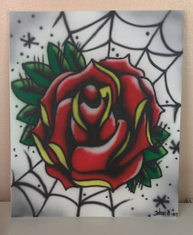 A traditional tattoo rose made with airbrush on canvas