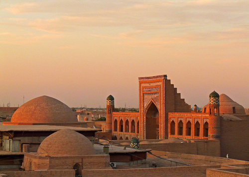 city travel pink roof light sunset architecture buildings place panasonic explore dome uzbekistan khiva aky madressa swatimage rositaso kutligmurodinokmedressa