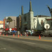 Chinese Theater With News Trucks