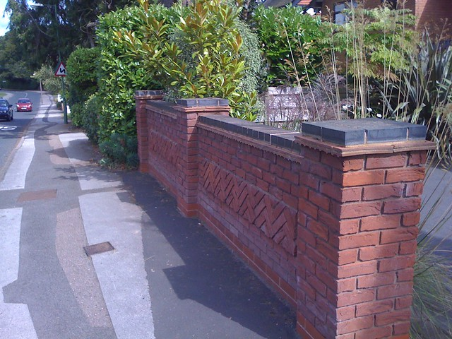 Blue brick top to garden wall long flickr photo sharing for Designs for brick garden walls