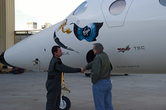 Burt Rutan congratulates pilot Pete Siebold on the VMS Eve's successful maiden flight. Credit Freddie Weston-Smith