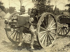 vehicle(0.0), horse and buggy(0.0), cannon(0.0), carriage(0.0), wheel(1.0), weapon(1.0), coachman(1.0), monochrome photography(1.0), monochrome(1.0), black-and-white(1.0),