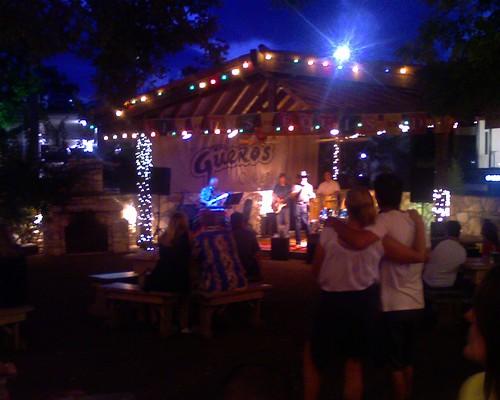 Enjoying live music at a taco bar.