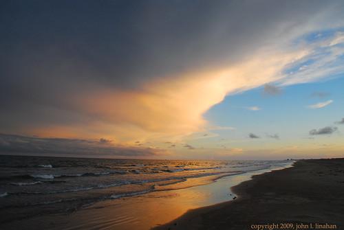 sunset sky orange reflection beach gulfofmexico water clouds evening nikon surf texas portaransas roygbiv d60 mustangisland 6050 nikonflickraward