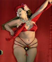 clothing(1.0), abdomen(1.0), muscle(1.0), leg(1.0), trunk(1.0), lady(1.0), human body(1.0), erotic dance(1.0), thigh(1.0), adult(1.0),