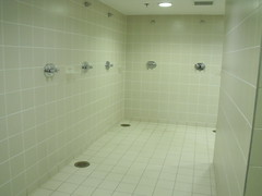 toilet(0.0), public toilet(0.0), bathtub(0.0), urinal(0.0), floor(1.0), room(1.0), property(1.0), plumbing fixture(1.0), shower(1.0), tile(1.0), bathroom(1.0), flooring(1.0),