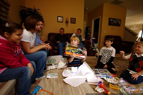 Ian opens another present, and some of the crowd goes wild!    MG 6407