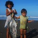 Mechapa children at sunrise, after dad comes home from night's catch
