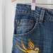 embroidered & appliqued bird jeans closer