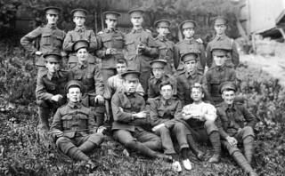 British soldiers of World War One - The 21st Battalion,  London Regiment (1st Surrey Rifles) - Note, front row 2nd from left is George Henry Kemp ( sitting, arms crossed & pipe in mouth ) | by DesertBlooms