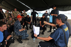 SINGAPORE (May 19, 2011) Members of the USS McCampbell (DDG 85) visit, board, search and seizure (VBSS) team conduct a post mission brief with members of the Republic of Singapore navy and Royal New Zealand Navy, following a VBSS training evolution. (U.S. Navy photo by Mass Communication Specialist 3rd Class Charles Oki)