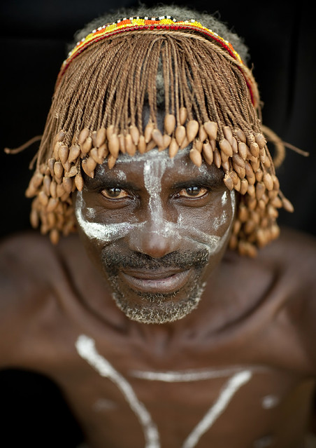 Tharaka warrior with a traditional wig - Kenya
