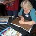 Jackie signing books