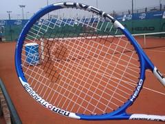 ball(0.0), ball(0.0), strings(1.0), sport venue(1.0), tennis(1.0), sports equipment(1.0), rackets(1.0), net(1.0),