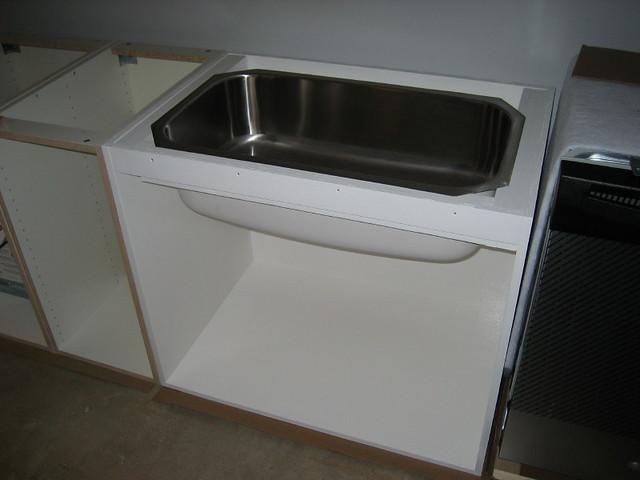 Straightening a warped cabinet door - Fine Homebuilding Tip
