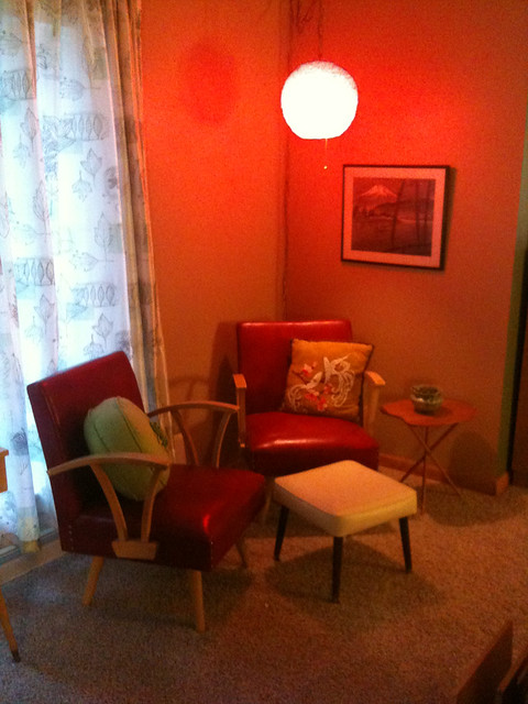 Retro red rocking chairs & spaghetti lamp