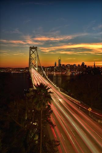sanfransicobaybridge bridge baybridge sunset longexposure i80 yrebabuenaisland orangehour road traffic night urban citylife landscape cityscape sanfrancisco composite