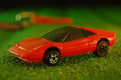 lamborghini countach(0.0), race car(1.0), model car(1.0), automobile(1.0), ferrari 288 gto(1.0), vehicle(1.0), performance car(1.0), automotive design(1.0), ferrari 308 gtb/gts(1.0), ferrari 328(1.0), land vehicle(1.0), luxury vehicle(1.0), supercar(1.0), sports car(1.0),