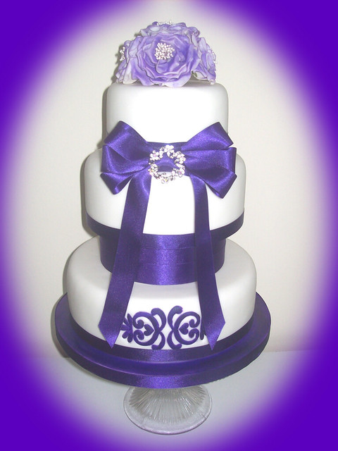 Cadbury Puple Wedding Cake 3 tier cake with deep purple satin ribbon and