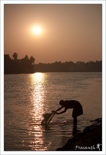 sunset man sunrise canon river clothes washing glod 1000d shilioute