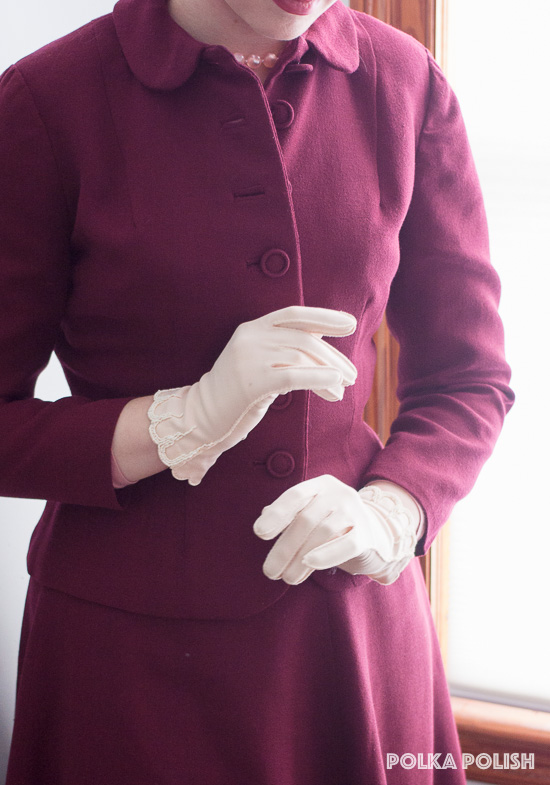 Burgundy 1940s suit paired with petal pink gloves with beaded trim