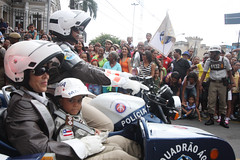 racing(0.0), pit stop(0.0), race track(0.0), protest(0.0), race(1.0), demonstration(1.0), motorcycling(1.0),