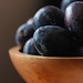Plums in a bowl in the light