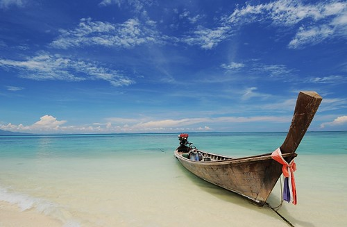 long tail boat on bamboo island