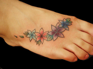 Stunning celebrity tattoos 25 charming norwegian flower for Norwegian flower tattoo
