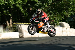 supermoto(0.0), stunt performer(0.0), automobile(1.0), superbike racing(1.0), racing(1.0), wheel(1.0), vehicle(1.0), race(1.0), motorcycle(1.0), motorsport(1.0), motorcycle racing(1.0), road racing(1.0), extreme sport(1.0), motorcycling(1.0), stunt(1.0), isle of man tt(1.0),