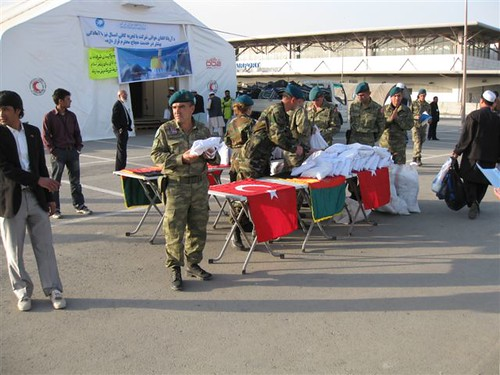 ISAF soldiers provide aid at Kabul airport.