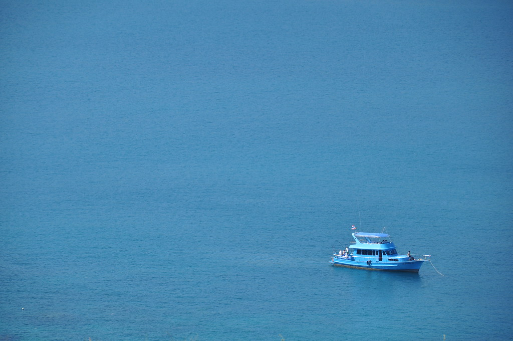 Blue yacht on blue waters