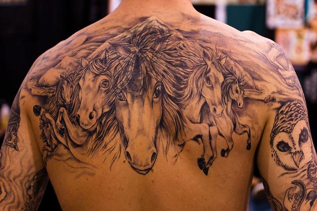 Horses tattoo closeup