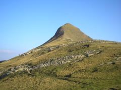 spoil tip(0.0), plain(0.0), mountain range(0.0), ridge(0.0), monument(0.0), butte(0.0), mountain(1.0), mound(1.0), hill(1.0), summit(1.0), geology(1.0), fell(1.0), landscape(1.0), badlands(1.0), grassland(1.0), mountainous landforms(1.0),