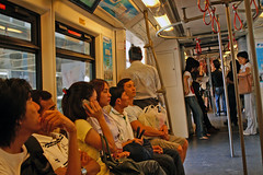 Passengers on the BTS Skytrain in Bangkok