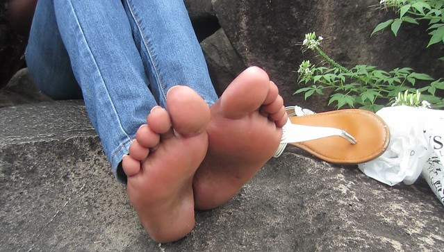 Shy Caribbean girl with sandal soles size 10