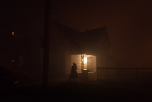 The Fire: Walking by a House in the Haze