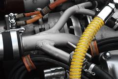 tire(0.0), automotive tire(0.0), automotive exterior(0.0), wheel(0.0), exhaust system(0.0), rim(0.0), steering wheel(0.0), bumper(0.0), engine(1.0),