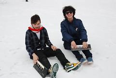 skating(0.0), winter sport(0.0), vehicle(0.0), ice skating(0.0), sled(0.0), snowshoe(1.0), footwear(1.0), winter(1.0), snow(1.0),
