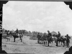 Expedition members on horses