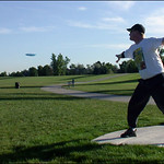 Dave Widhalm drives the short hole #7 at Expo Park opening.