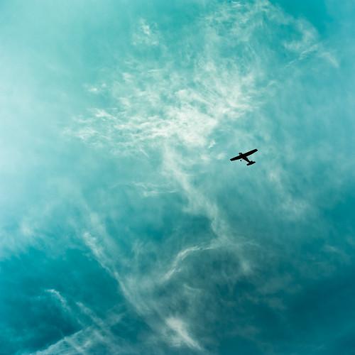 Plane / Sky / Clouds