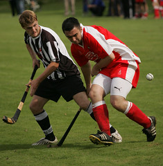 football player(0.0), rugby football(0.0), stick and ball games(1.0), sports(1.0), team sport(1.0), hockey(1.0), field hockey(1.0), tackle(1.0), player(1.0), ball game(1.0),