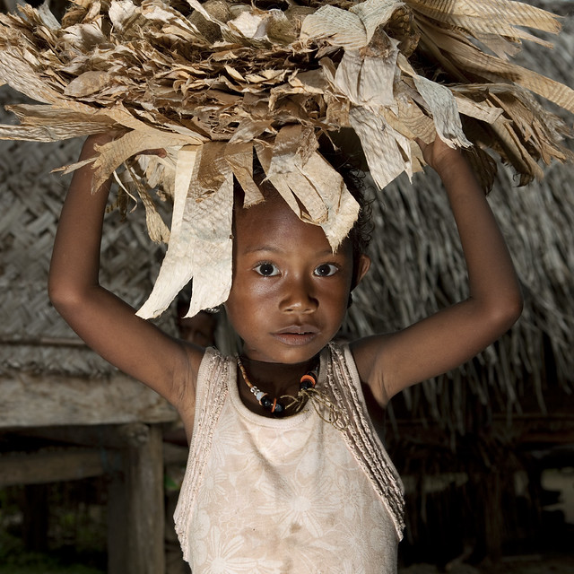Carrying traditional Doba money - Trobriand Papua New Guinea