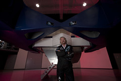 Sir Richard Branson in front of the NASTAR Centrifuge. Credit Mark Greenberg