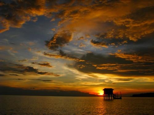 sun setting over kuala gula