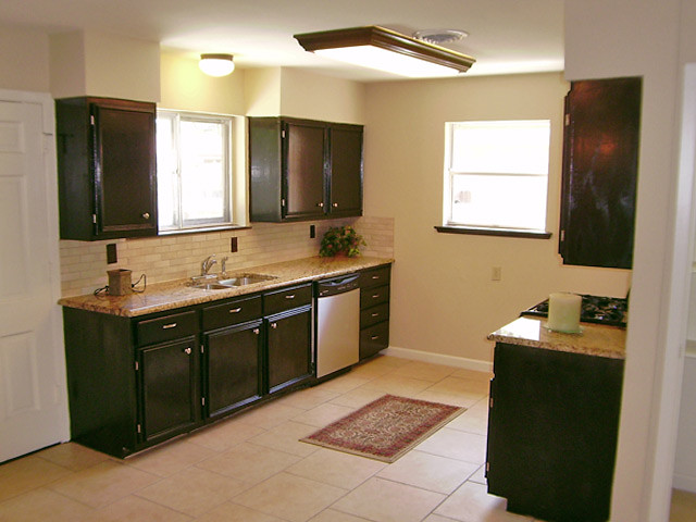 Refurbished Kitchen Cabinets | This view of the kitchen is f ...